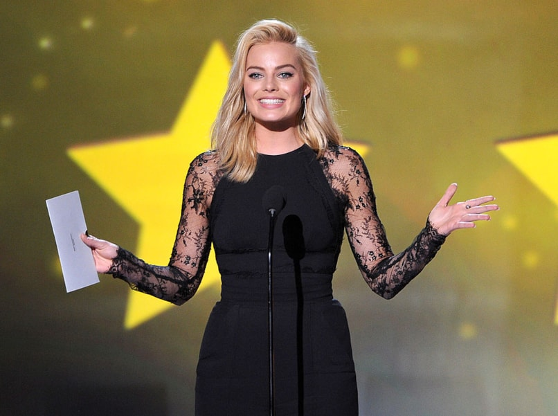 SANTA MONICA, CA - JANUARY 16:  Actress Margot Robbie speaks onstage during the 19th Annual Critics' Choice Movie Awards at Barker Hangar on January 16, 2014 in Santa Monica, California.  (Photo by Kevin Winter/Getty Images)
