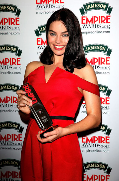LONDON, ENGLAND - MARCH 30:  Margot Robbie, winner of the Best Female Newcomer award for 'The Wolf Of Wall Street' poses during the Jameson Empire Awards 2014 at the Grosvenor House Hotel on March 30, 2014 in London, England. Regarded as a relaxed end to the awards show season, the Jameson Empire Awards celebrate the film industry's success stories of the year with winners being voted for entirely by members of the public. Visit empireonline.com/awards2014 for more information.  (Photo by Tim P. Whitby/Getty Images for Jameson)