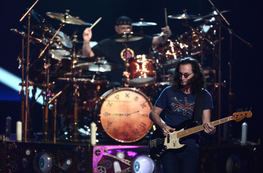 LOS ANGELES, CA - APRIL 18:  Musicians Neil Peart (L) and Geddy Lee of Rush perform on stage at the 28th Annual Rock and Roll Hall of Fame Induction Ceremony at Nokia Theatre L.A. Live on April 18, 2013 in Los Angeles, California.  (Photo by Kevin Winter/Getty Images)